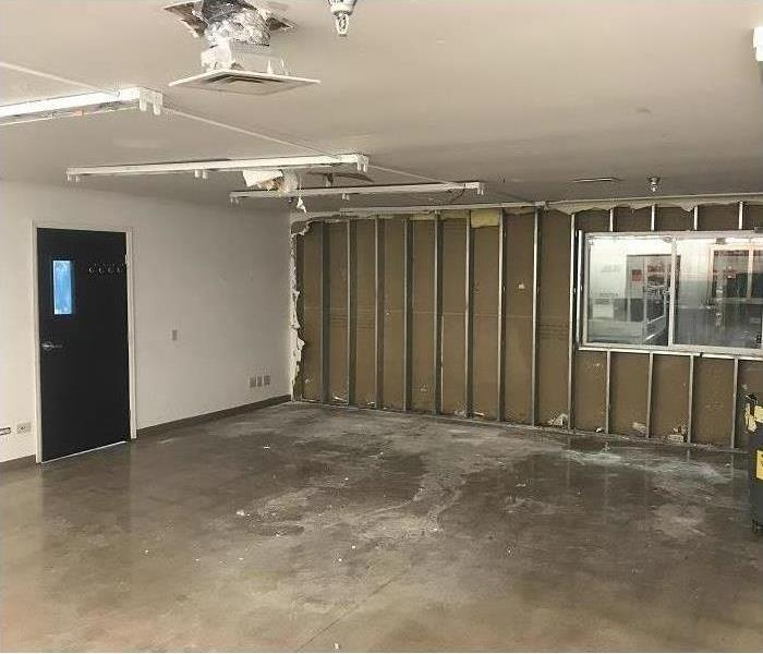 Concrete floor with water extracted and drywall removed