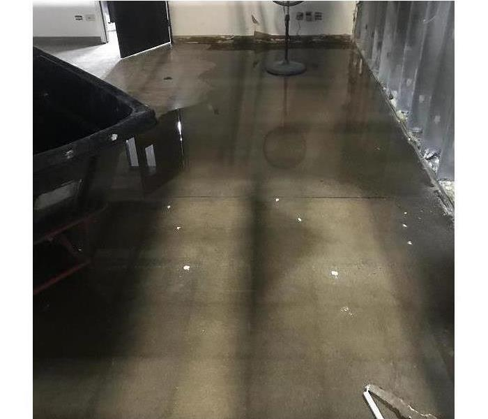 Concrete floor with standing water