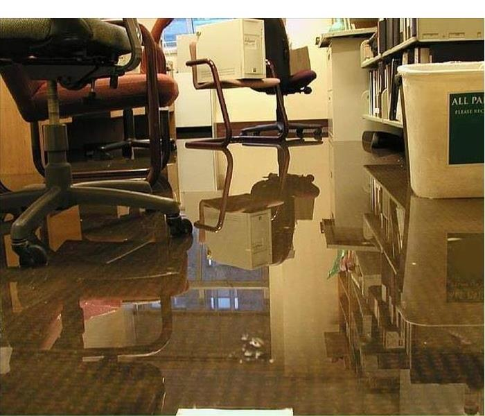 office space with layer of water on carpeting