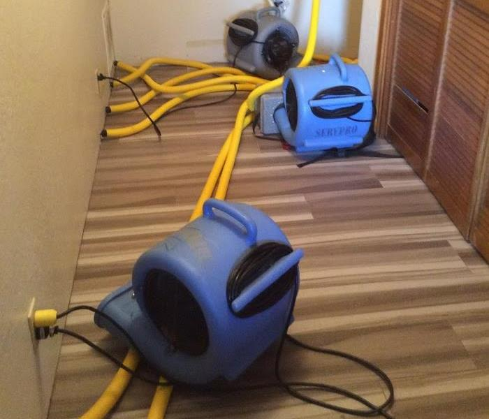 Water Damage Extracting water from hardwood floors
